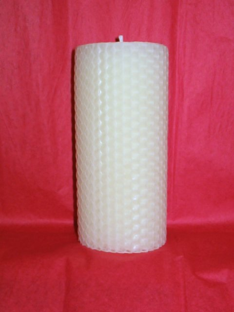 This is our 4 inch x 2.5 inch Handrolled Beeswax Pillar.
